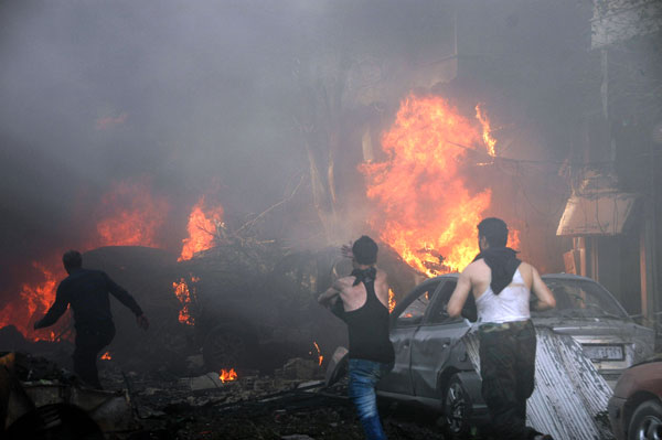 Two car bombs kill 25 in Homs