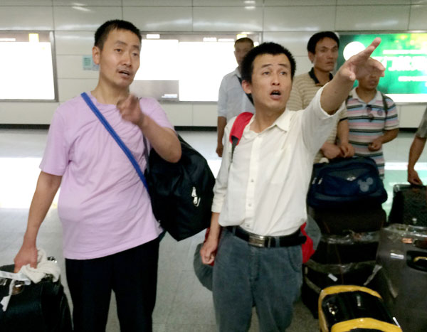 Evacuated Chinese fly home from Iraq