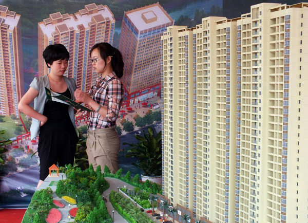 China moves to regulate real estate agencies