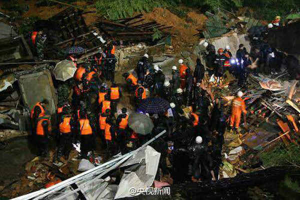 Survivors found as dozens buried in landslide