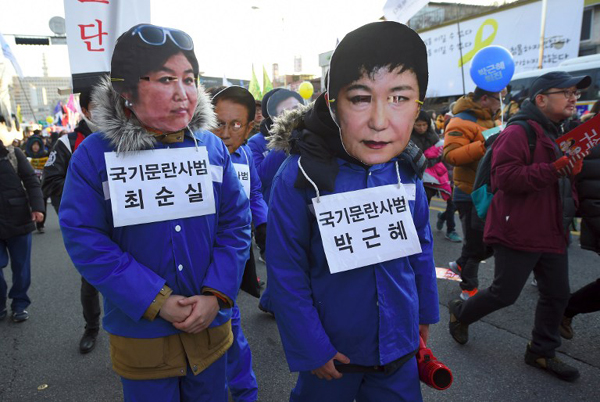 South Korea prosecutors charge 2 ex-Park officials