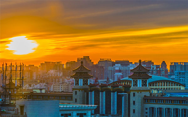 Beijing wakes to rosy dawn
