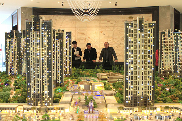 China's Dec home price growth moderates, bubble fears abate