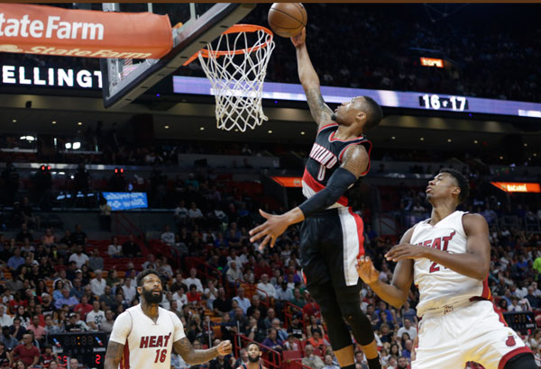 Trail Blazers beats Heat, Cleveland edges Lakers