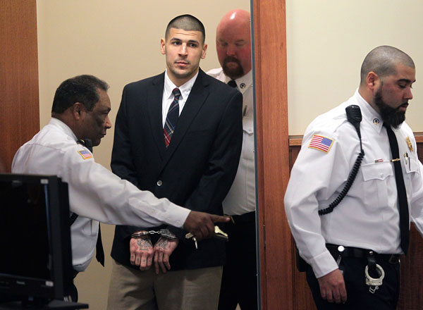Ex-NFL star Aaron Hernandez hangs himself in his prison cell