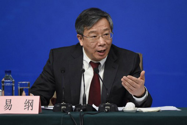 Official: China's bad loans stabilize, capital flight eases