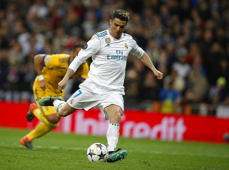 late ronaldo penalty keeps madrid alive in champions league