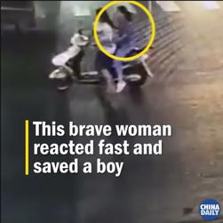 woman_saves_boy.jpg