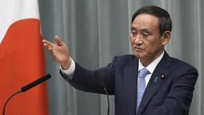In this Sept 11, 2019, file photo, Yoshihide Suga, Chief Cabinet Secretary speaks during a press conference at the prime minister's official residence in Tokyo. Chief Cabinet Secretary Suga told reporters that a Japanese fisheries inspection ship received a distress call from another North Korean boat of the capsizing. He said the Japanese fisheries and coast guard patrol boats are jointly searching for the missing.