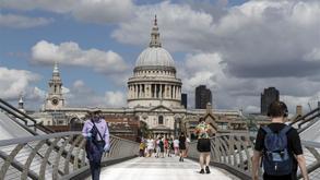 People walk on the Millennium Bridge.jpg