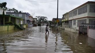 Hurricane Maria hit Puerto Rico and had hundreds of homes destroyed, power knocked out across the entire island and turned some streets into raging rivers.